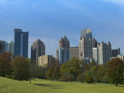 Row of trees in Piedmont park with view of Atlanta Ga skyline